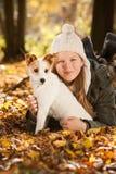 Muchacha con el perro Imagen de archivo libre de regalías