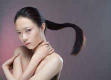 Muchacha con el ponytail del vuelo Imagen de archivo libre de regalías
