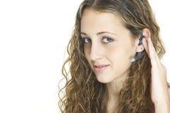 Muchacha con el receptor de cabeza Fotos de archivo libres de regalías