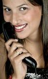 Muchacha con el receptor de teléfono Fotos de archivo