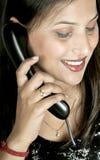 Muchacha con el receptor de teléfono Imagen de archivo libre de regalías