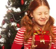 Muchacha con el rectángulo de regalo Imagenes de archivo