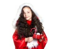 Muchacha con el regalo de la Navidad Foto de archivo