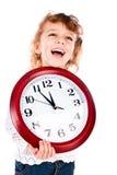 Muchacha con el reloj Foto de archivo libre de regalías