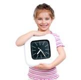 Muchacha con el reloj grande Fotografía de archivo libre de regalías