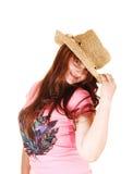 Muchacha con el sombrero de paja. Fotografía de archivo libre de regalías