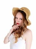 Muchacha con el sombrero de paja. Imagen de archivo libre de regalías