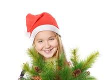 Muchacha con el sombrero de Papá Noel Foto de archivo libre de regalías