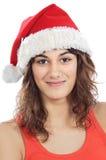 Muchacha con el sombrero de Papá Noel Fotografía de archivo libre de regalías