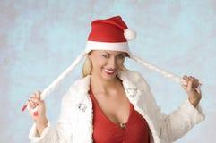 Muchacha con el sombrero de Papá Noel Imagen de archivo