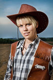 Muchacha con el sombrero de vaquero Fotos de archivo libres de regalías