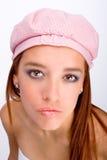 Muchacha con el sombrero rosado Imagen de archivo libre de regalías