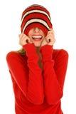 Muchacha con el sombrero tirado sobre sus ojos Foto de archivo