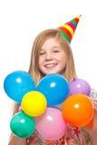 Muchacha con el sombrero y los globos del partido Imagen de archivo