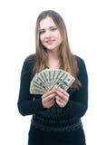 Muchacha con el taco del dinero en sus manos Foto de archivo