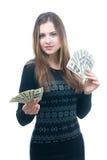 Muchacha con el taco del dinero en sus manos fotografía de archivo