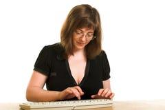 Muchacha con el teclado Imagenes de archivo