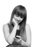 Muchacha con el teléfono Foto de archivo