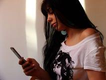 Muchacha con el teléfono Imágenes de archivo libres de regalías