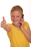 Muchacha con el teléfono celular Imagenes de archivo