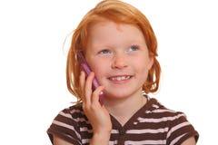Muchacha con el teléfono celular Fotos de archivo libres de regalías