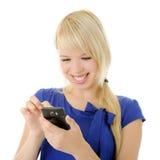 Muchacha con el teléfono elegante Foto de archivo