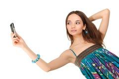 Muchacha con el teléfono móvil Foto de archivo libre de regalías