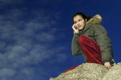 Muchacha con el teléfono móvil Fotografía de archivo libre de regalías