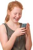 Muchacha con el teléfono móvil Fotos de archivo