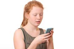 Muchacha con el teléfono móvil Imagenes de archivo