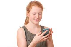 Muchacha con el teléfono móvil Fotos de archivo libres de regalías