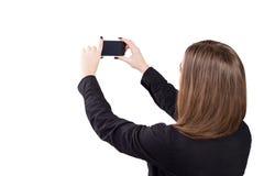 Muchacha con el teléfono móvil a disposición Estilo del asunto Fotografía de archivo