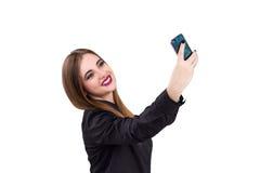 Muchacha con el teléfono móvil a disposición Estilo del asunto Foto de archivo libre de regalías