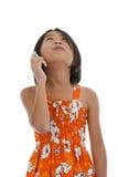Muchacha con el teléfono móvil que mira para arriba Imagen de archivo libre de regalías