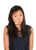 Muchacha con el termómetro en su boca Fotos de archivo libres de regalías