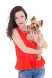 Muchacha con el terrier de Yorkshire del pequeño perro aislado en blanco Fotos de archivo libres de regalías