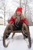Muchacha con el trineo Foto de archivo libre de regalías