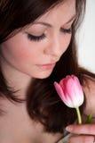 Muchacha con el tulipán Imagen de archivo