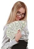 Muchacha con el ventilador de dólares Imagen de archivo