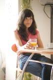 Muchacha con el vidrio Foto de archivo libre de regalías