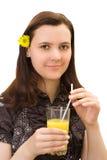 Muchacha con el vidrio de zumo de naranja Imagen de archivo