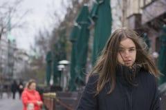 Muchacha con el viento en su pelo Foto de archivo libre de regalías