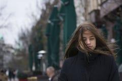 Muchacha con el viento en su pelo Imágenes de archivo libres de regalías