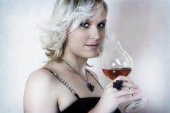 Muchacha con el vino Fotos de archivo