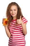 Muchacha con el zumo de manzana Fotos de archivo libres de regalías