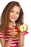 Muchacha con el zumo de manzana Imagenes de archivo