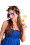 Muchacha con el zumo de naranja Imagen de archivo libre de regalías