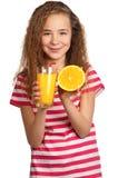 Muchacha con el zumo de naranja Imagen de archivo