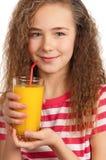 Muchacha con el zumo de naranja Imagenes de archivo