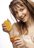 Muchacha con el zumo de naranja Imágenes de archivo libres de regalías